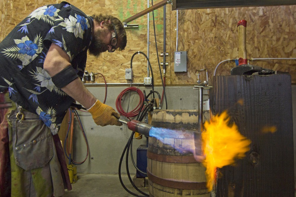 Nate heats up the cauterizer with the blow torch.