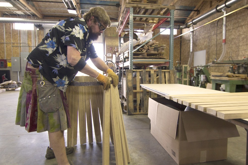 Assembling the staves, the first step in barrel making.