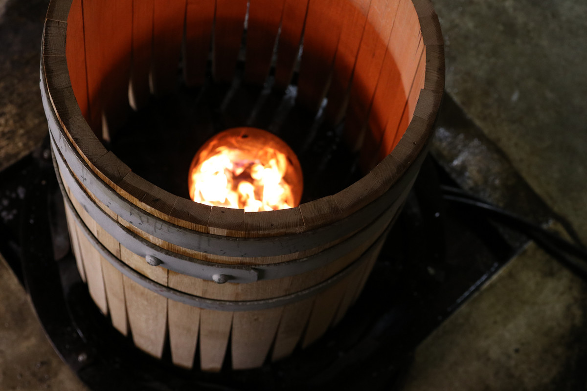 We built barrels like this one that is getting charred at Rogue Rolling Thunder Barrelworks in Newport, Oregon.