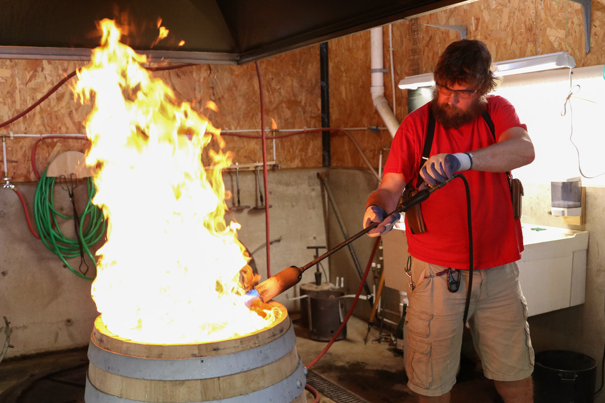 Rogue Cooper Nate Linquist charring a barrel at Rolling Thunder Barrel Works in Newport, Ore.