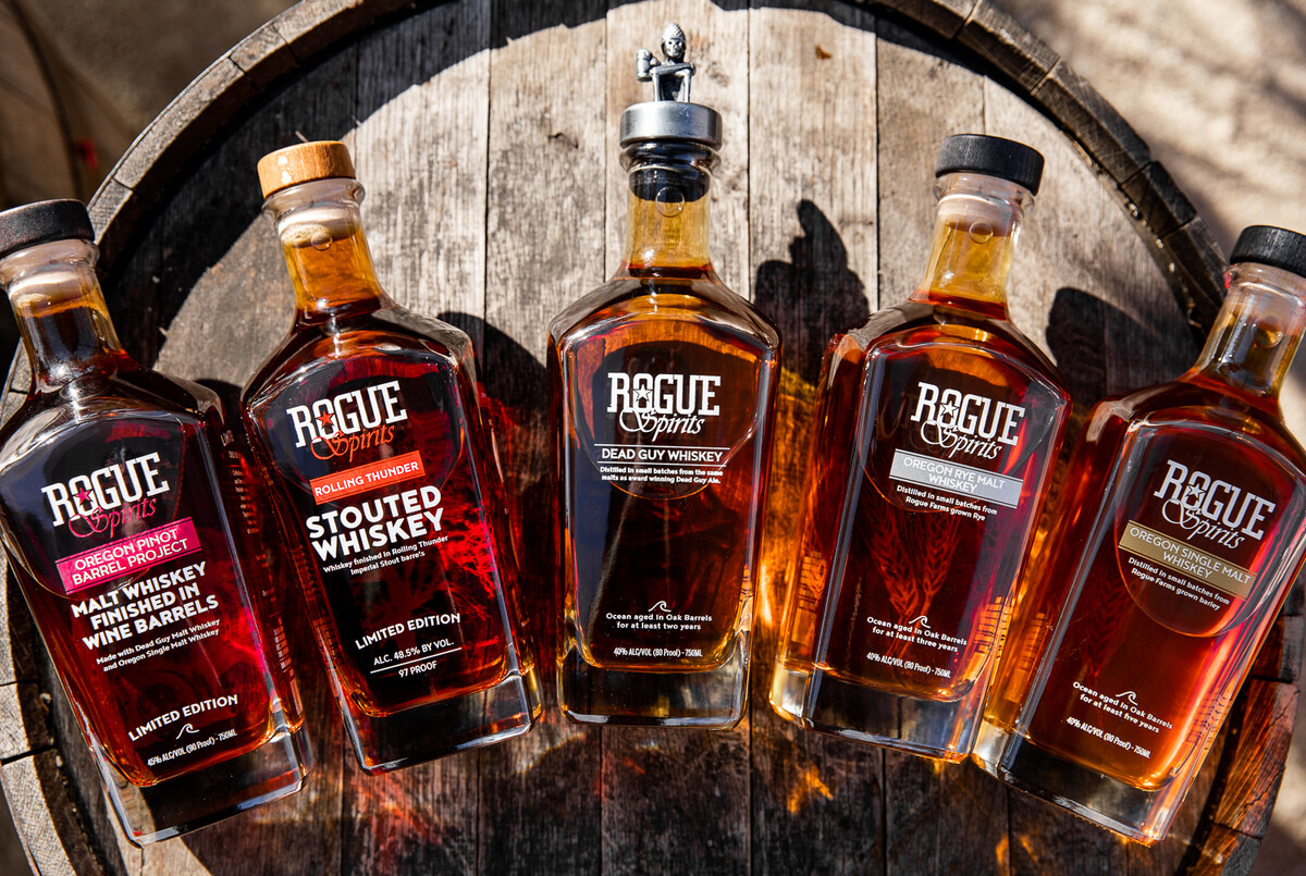 The Rogue Spirits lineup of whiskey from left to right: Oregon Pinot Barrel Project, Rolling Thunder Stouted Whiskey, Dead Guy Whiskey, Oregon Rye Malt Whiskey, Oregon Single Malt Whiskey.
