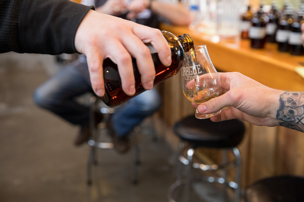 Brian Pribyl pours samples of Pinot noir barrel-aged whiskeys.