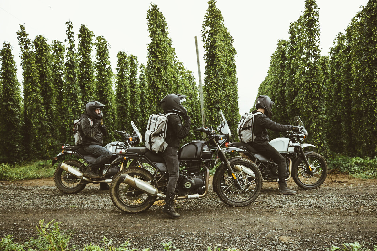 Three riders on Himalayans arrive at Rogue Farms in Independence, Oregon.