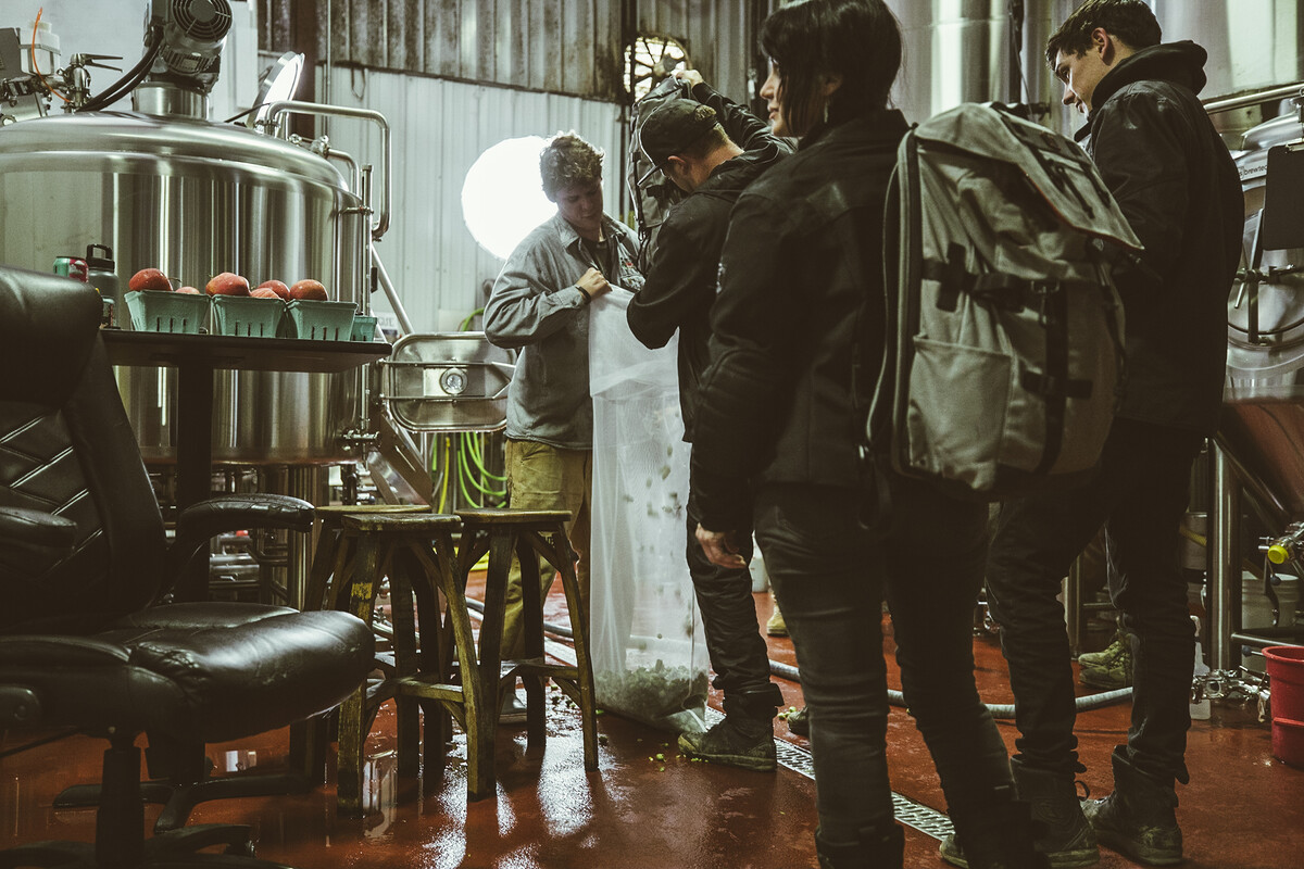 The three riders deliver their wet Mosaic hops to Rogue Innovation Brewer Michael King.