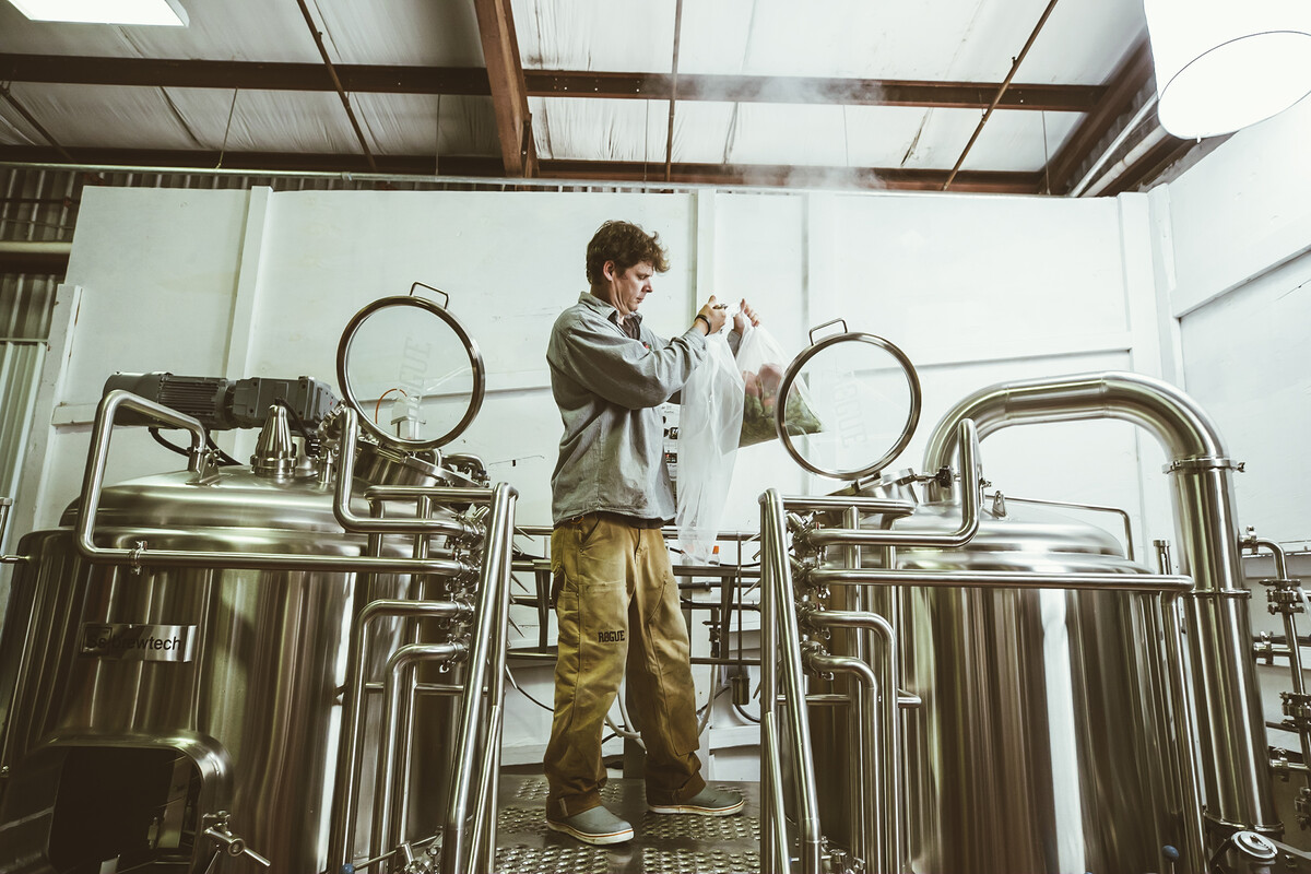 Rogue Innovation Brewer Michael King prepares to wet hop a hazy IPA.