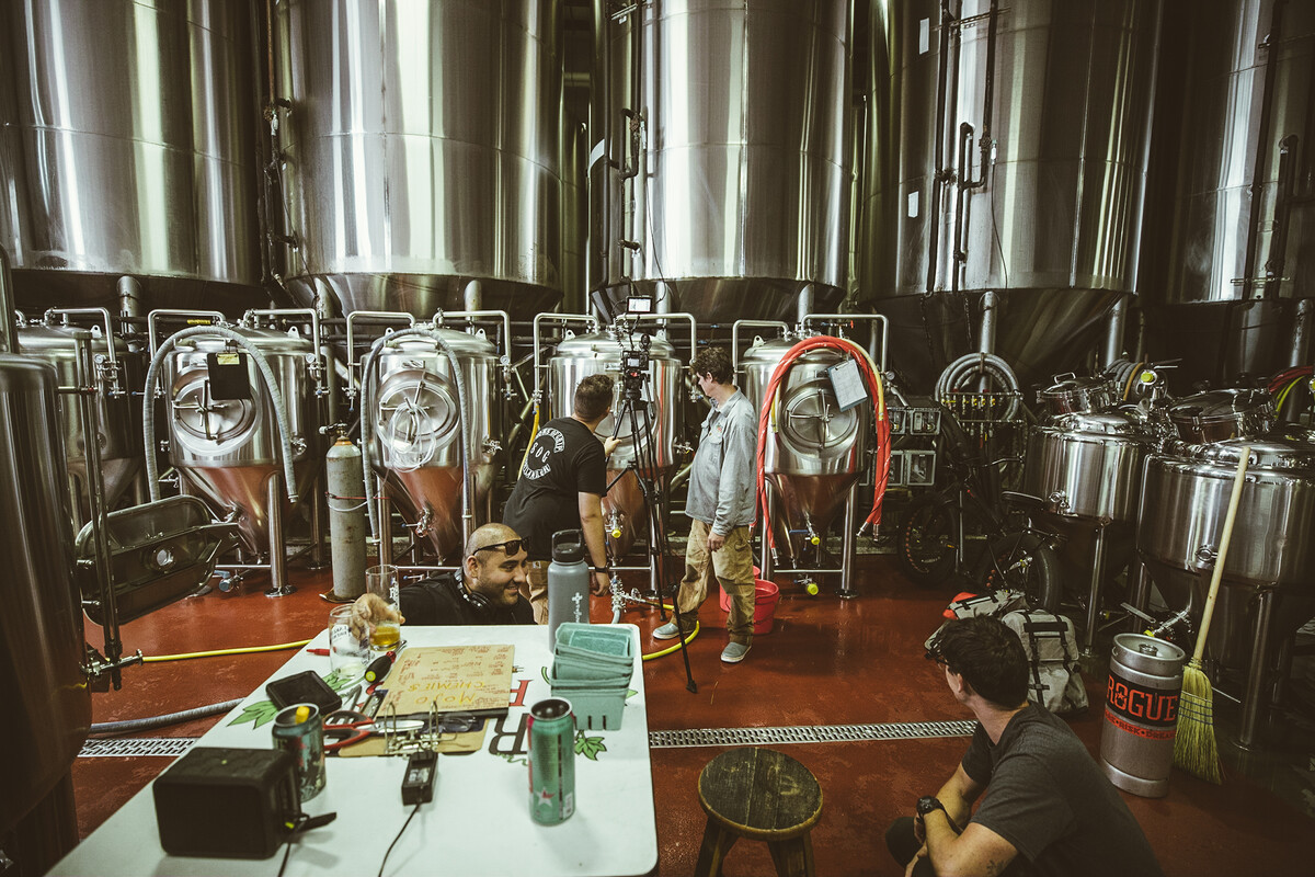 Rogue Innovation Brewer Michael King works with the film crew at Rogue World Headquarters in Newport,Oregon.