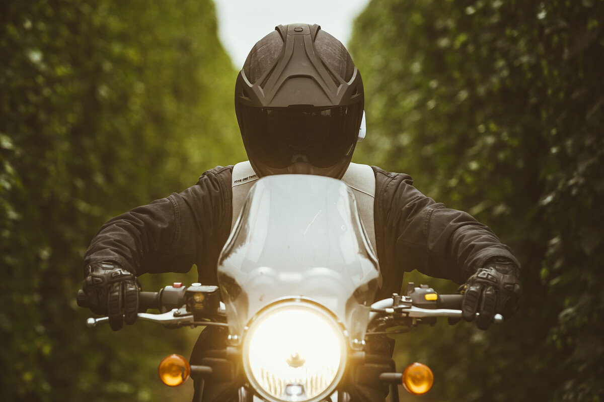 A rider on their Himalayan motorcycle traveling from Rogue Farms to Rogue World Headquarters.
