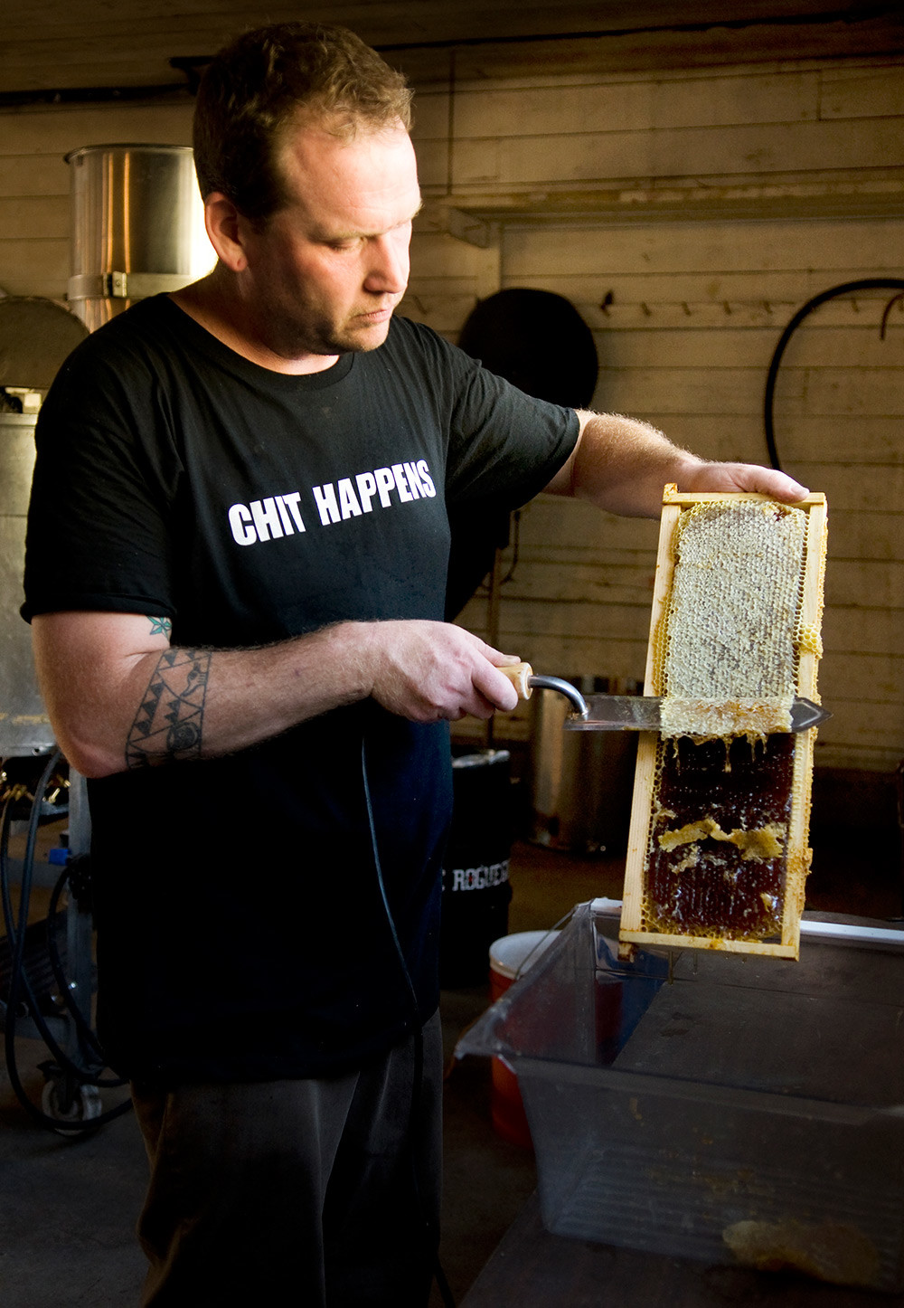 Slicing the beeswax off the honeycombs.