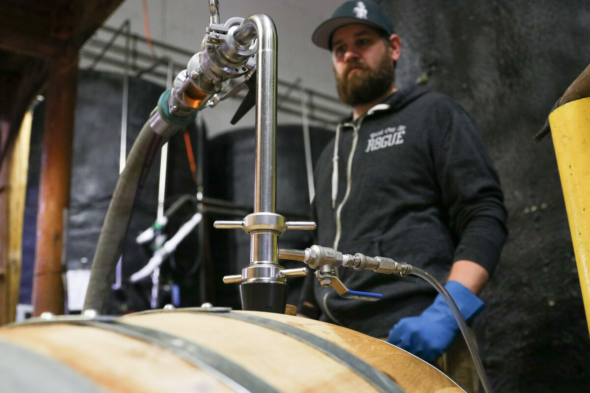 Rogue Brewmaster Joel Shields oversees racking for Dead 'N' Dead at Rogue World Headquarters in Newport, Oregon.