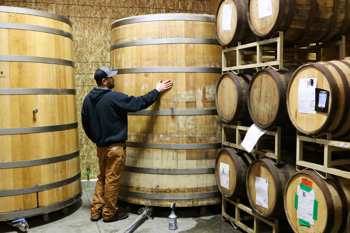 Rogue Brewmaster Joel Shields admires a foeder at Rogue World Headquarters in Newport, Oregon.