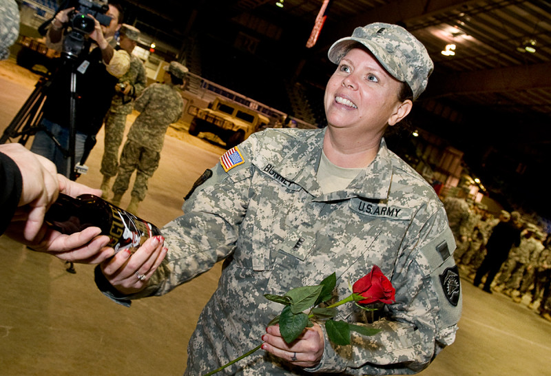 A member of the Oregon National Guard accepts a bottle of Rogue.