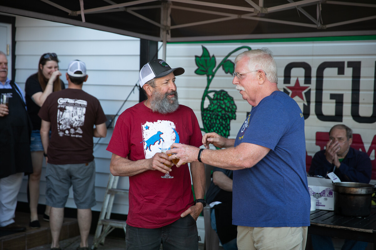 Rogue Brewmaster John Maier was on hand to help us present the check to the Newport Fishermen's Wives.