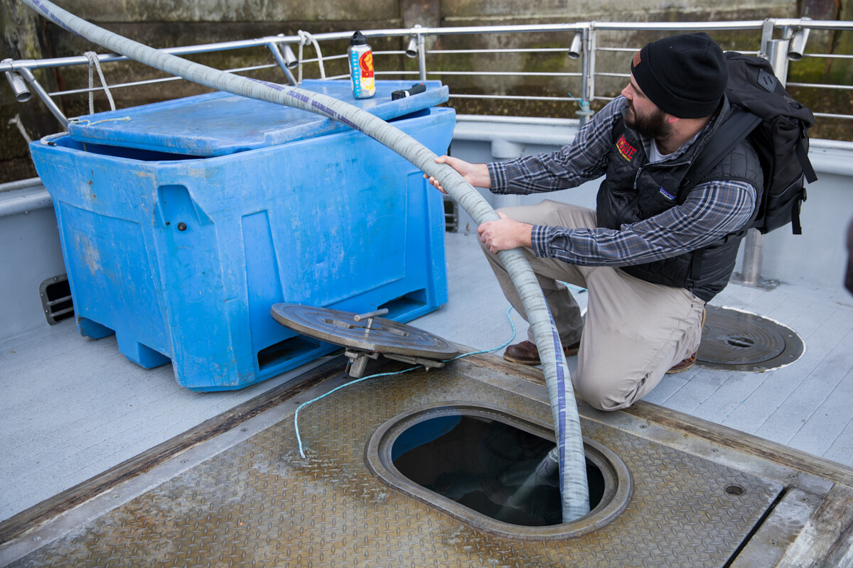 International Sales Manager Mike Knowles assists as the water is pumped from the crabbing boat into our brewery.